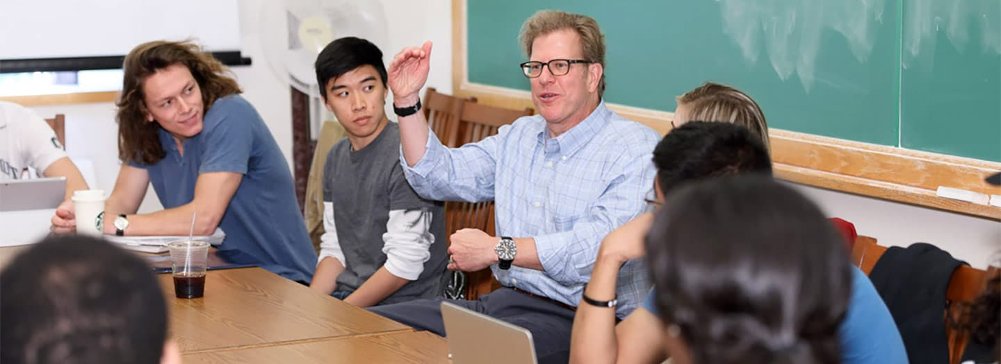 alumnus Wayne Waz from the class of 1984 speaks with students in Professor Steve Hilgartner's class