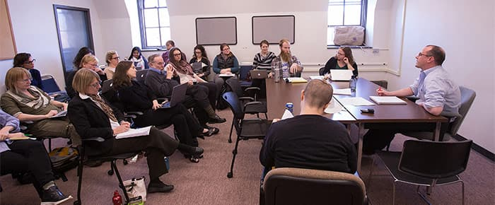STS students and faculty at a meeting of the social sciences reading group